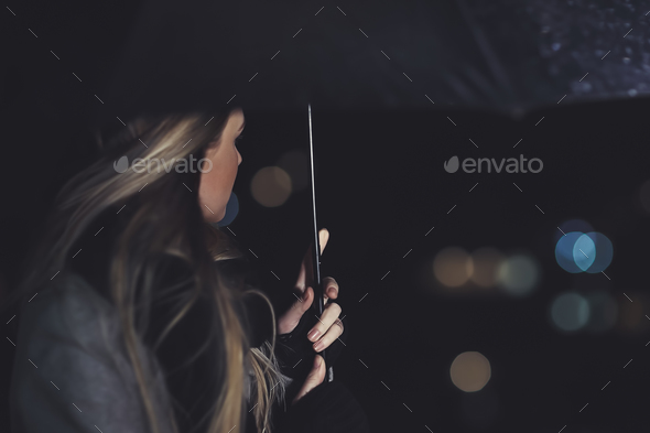 Female outdoors in rainy night - Stock Photo - Images