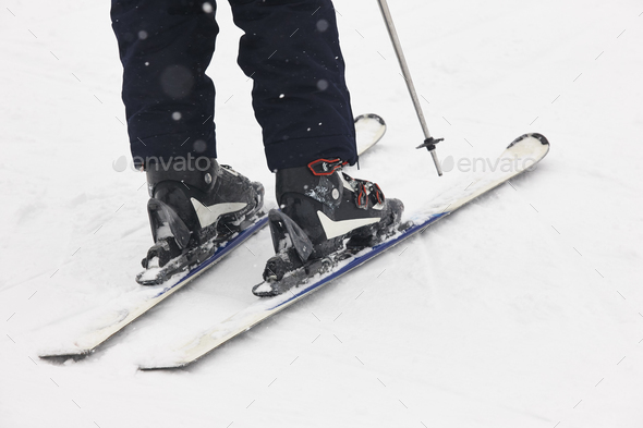 Boots and skis over the snow. Winter sport equipment detail. Horizontal - Stock Photo - Images