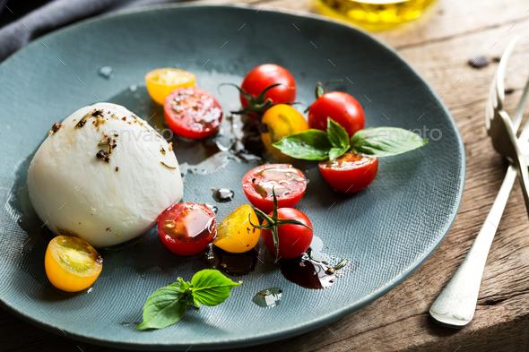 Mozzarella with Cherry Tomato salad - Stock Photo - Images