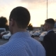 Two Young Businessmen Walking in Auto Parking at Sunset Time. Business Men Commuting to Work - VideoHive Item for Sale