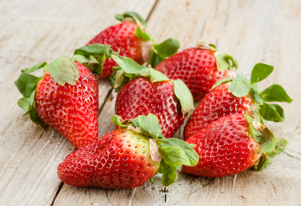 group of large strawberries on rustic kitchen table - Stock Photo - Images