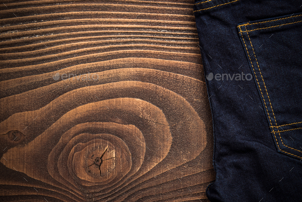 Dark jeans on wooden board - Stock Photo - Images