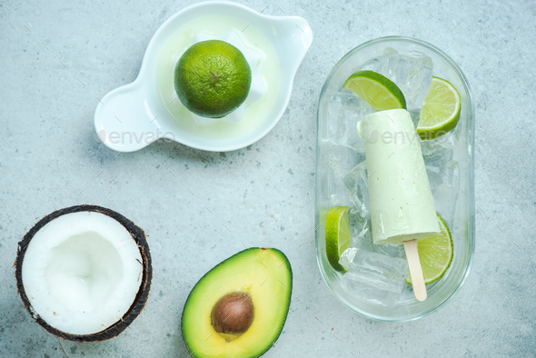 Avocado,lime and coconut healthy trendy popsicles - Stock Photo - Images