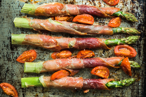 Prosciutto ham wrapped around asparagus - Stock Photo - Images