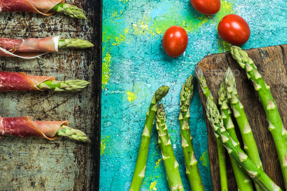 Coocking asparagus with prosciutto wraps - Stock Photo - Images