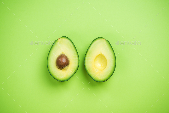 Avocados halves creative food concept - Stock Photo - Images