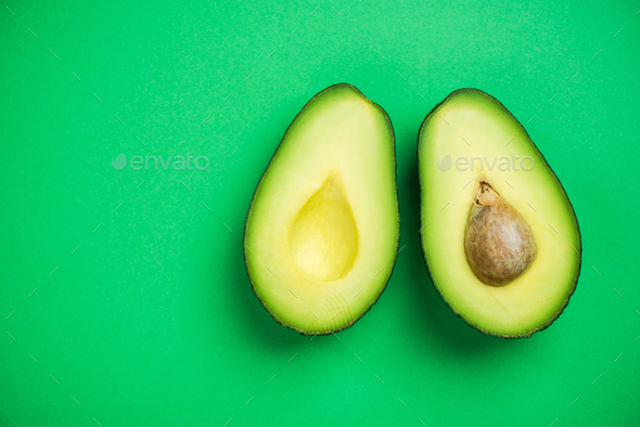 Avocado on pastel background,creative food concept - Stock Photo - Images