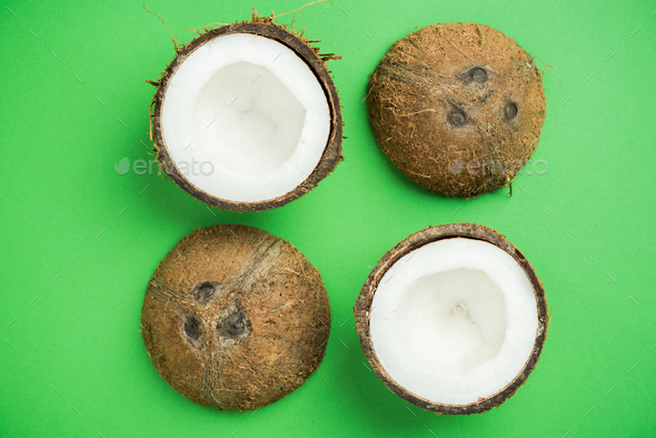 Coconut on green pastel background - Stock Photo - Images