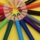 Colored Pencils Lying on Bright Yellow Background in a Circle. - VideoHive Item for Sale