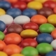 Colorful Chocolate Coated Drops Candy Lying on the Table - VideoHive Item for Sale