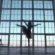 Silhouette of a Ballerina on a Background of a Large Window