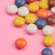 Pile of Colorful Chocolate Coated Candy on Pink Background. - VideoHive Item for Sale