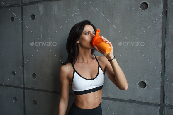 fitness woman drink cocktail - Stock Photo - Images
