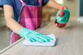 Young woman in protective gloves using a duster and spray - PhotoDune Item for Sale