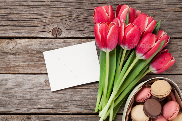 Red tulip flowers and macaroon cookies - Stock Photo - Images