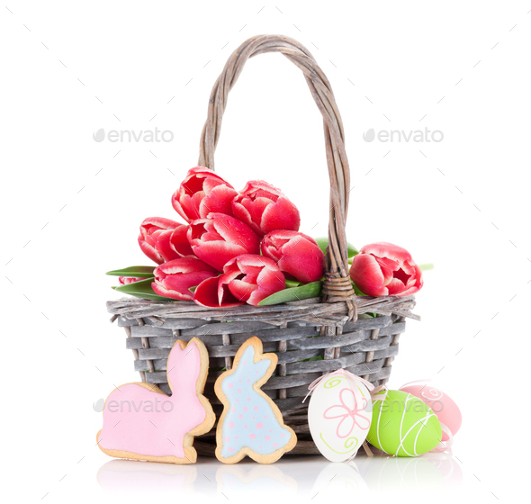 Red tulip flowers and Easter cookies and eggs - Stock Photo - Images
