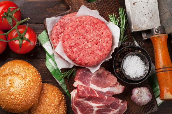 Raw minced beef meat and ingredients for burgers - Stock Photo - Images