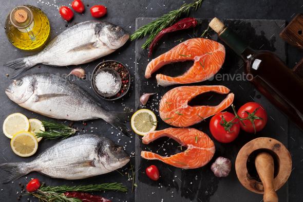 Raw salmon and dorado fish fillet - Stock Photo - Images