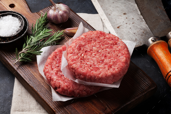 Raw minced beef meat for home made burgers - Stock Photo - Images
