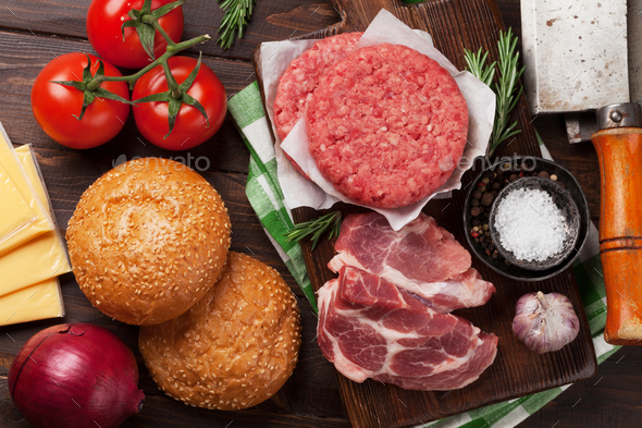 Tasty grilled home made burger cooking - Stock Photo - Images