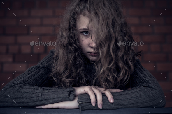 Portrait of a young sad girl. - Stock Photo - Images