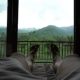Young Happy Man Relaxing on Country House Veranda, Point of View Feet Lay on Bed, Wonderful Green - VideoHive Item for Sale