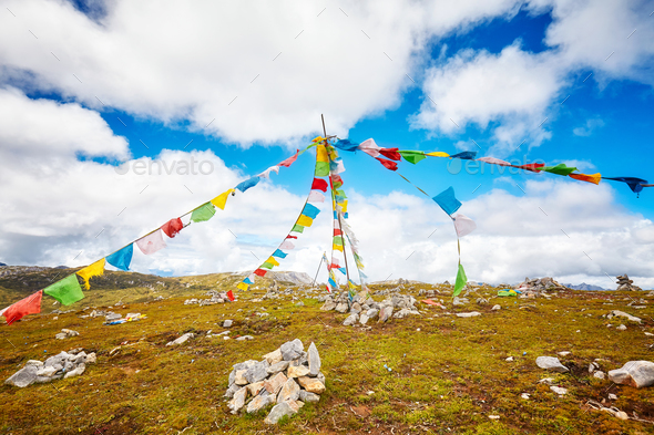 Buddhist prayer flags on the top of a mountain. - Stock Photo - Images