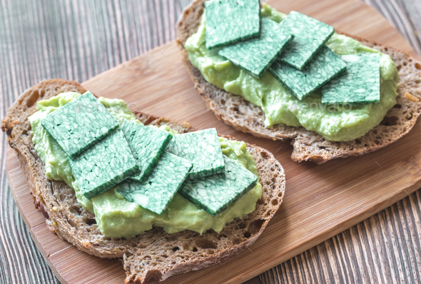 Slices of toasted bread with avocado paste - Stock Photo - Images