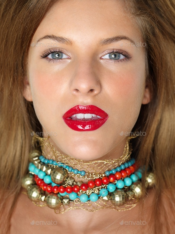 closeup beauty portrait woman with colorful jewels - Stock Photo - Images