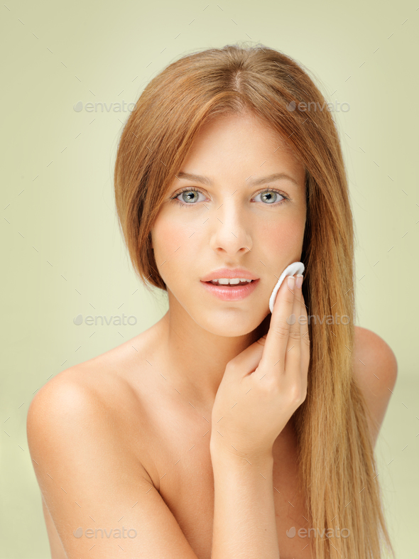 young blonde woman removing makeup - Stock Photo - Images