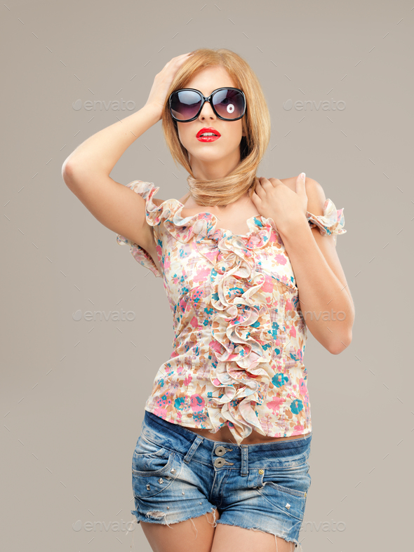 sexy blonde woman with sunglasses posing - Stock Photo - Images