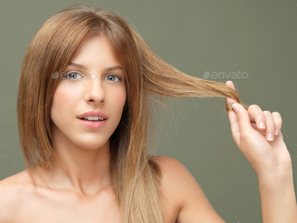 happy woman playing with her hair - Stock Photo - Images