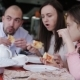Happy Family in a Cafe Happy To Eat Pizza and Socialize with Each Other - VideoHive Item for Sale