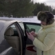 Senior Woman Using Mobile Phone for Calling Standing Nearly Car on Winter Road - VideoHive Item for Sale