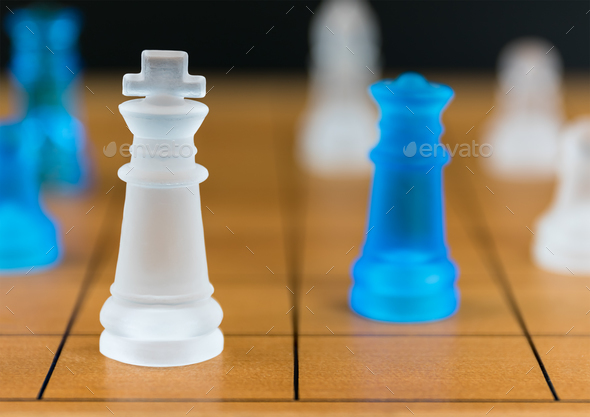 Chess glass on a wood chessboard - Stock Photo - Images