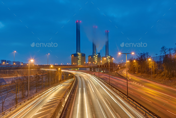 Power station and highway at night - Stock Photo - Images