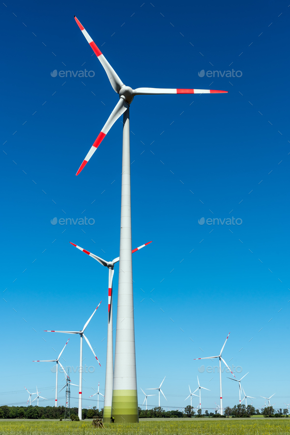 Wind energy plants on a sunny day - Stock Photo - Images