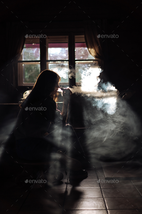 The girl smoke electronic cigarette - Stock Photo - Images