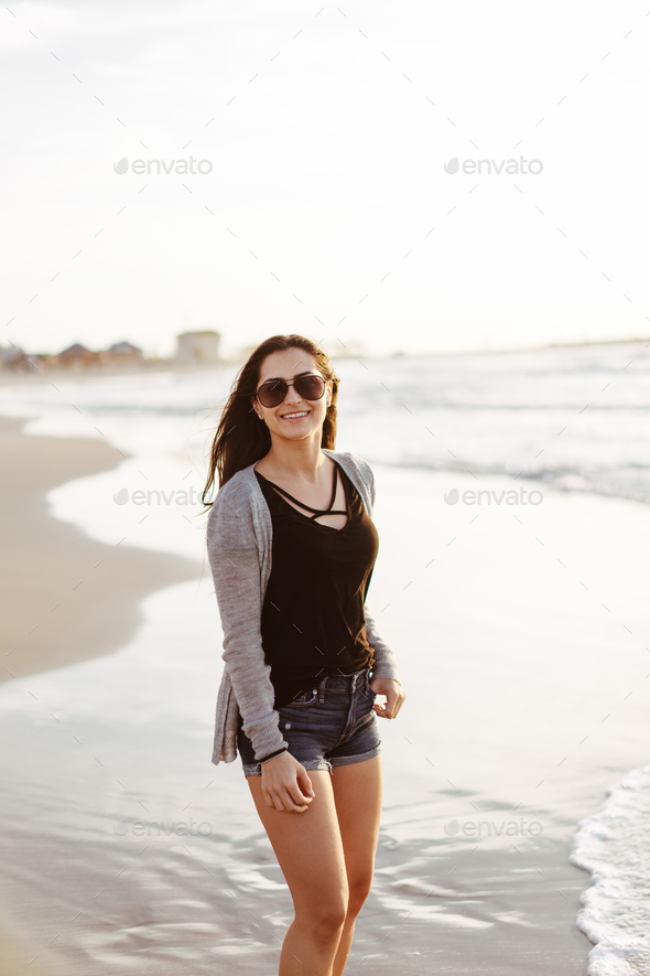 Young beautiful girl posing by the sea - Stock Photo - Images