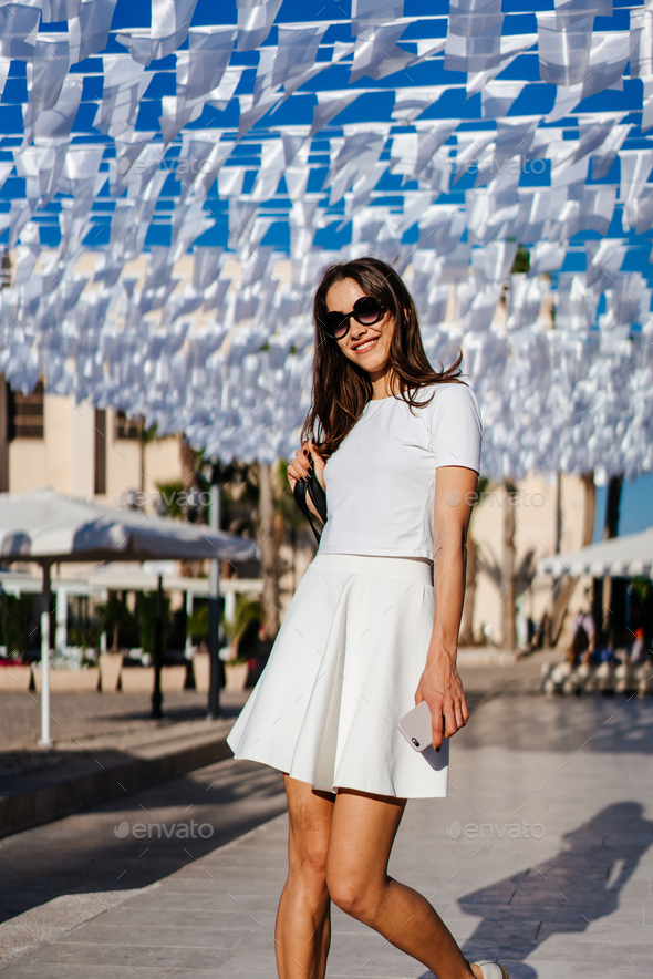 Beautiful woman young brunette wear in white dress - Stock Photo - Images