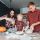 Dad, mom and little son cook a pie - PhotoDune Item for Sale