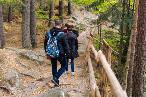 man and woman walking along hiking trail - Stock Photo - Images