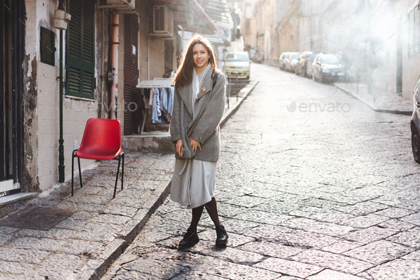 Woman walking in the old town. - Stock Photo - Images
