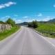 Driving a Car on a Road in Norway Atlantic Ocean Road