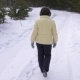 Elderly Woman Smiling and Waving Hand During Walking in Winter Forest - VideoHive Item for Sale