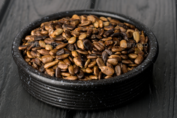 sunflower seeds toasted in clay pot - Stock Photo - Images