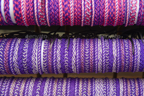 Ultra violet wristbands. Purple textured background. Hand made. Horizontal - Stock Photo - Images