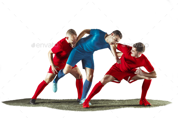 Football players tackling for the ball over white background - Stock Photo - Images