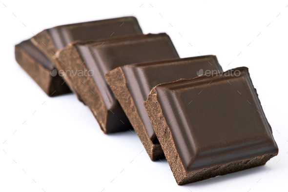 black chocolate chunks, arranged on white base - Stock Photo - Images