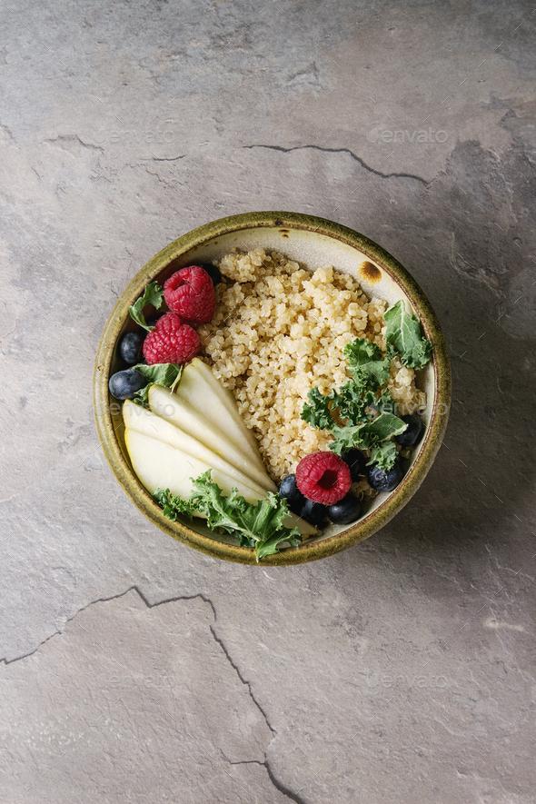 Quinoa porrige with kale - Stock Photo - Images